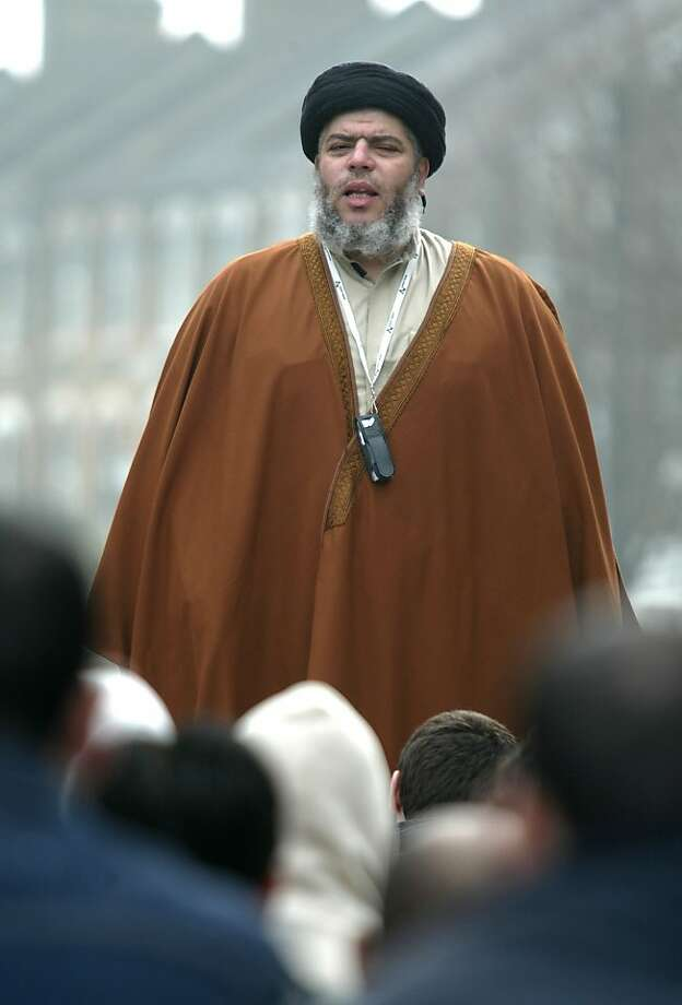 In this March 28, 2003 file photo, radical Muslim cleric Abu Hamza al-Masri prays in a street outside his Mosque in north London Europe's human rights court ruled on Tuesday, April 10, 2012 that it would be legal for Britain to extradite an Egyptian-born radical Muslim cleric and five other terror suspects to the United States. Photo: Alastair Grant, Associated Press