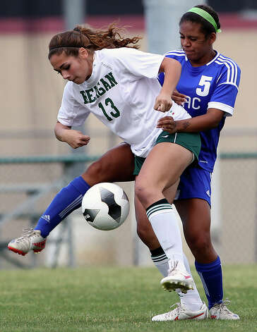 Reagan's Sophia Acevado tangles with MacArthur's Alexis Brown as the Brahmas take on the Rattlers in the playoffs at Blossom Soccer Stadium on Tuesday, April 10, 2012. Photo: TOM REEL, San Antonio Express-News / San Antonio Express-News