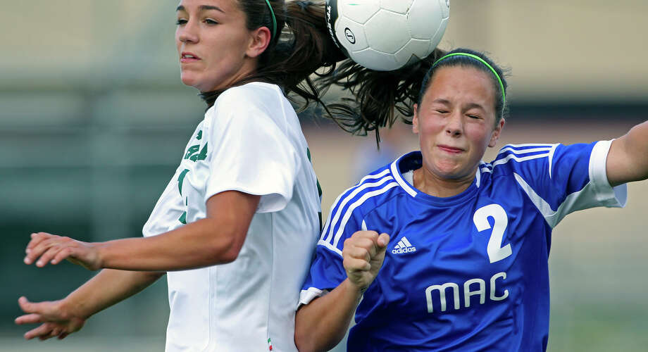 MacArthur's Madison Kingsbury controls against Reagan's Caitlin Owen as the Brahmas take on the Rattlers in the playoffs at Blossom Soccer Stadium on Tuesday, April 10, 2012. Photo: TOM REEL, San Antonio Express-News / San Antonio Express-News