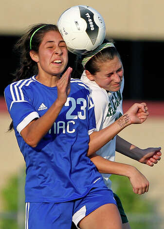 MacArthur's Stephanie Figueroa (23) and Reagan's Ashley Long crunch a header together as the Brahmas take on the Rattlers in the playoffs at Blossom Soccer Stadium on Tuesday, April 10, 2012. Photo: TOM REEL, San Antonio Express-News / San Antonio Express-News