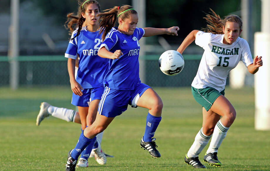 MacArthur's Madison Kingsbury heads upfield as the Brahmas take on the Rattlers in the playoffs at Blossom Soccer Stadium on Tuesday, April 10, 2012. Photo: TOM REEL, San Antonio Express-News / San Antonio Express-News