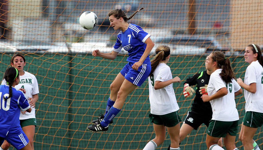 MacArthur's Brianna Livecchi  tries to set up a goal in the Reagan net as the Brahmas take on the Rattlers in the playoffs at Blossom Soccer Stadium on Tuesday, April 10, 2012. Photo: TOM REEL, San Antonio Express-News / San Antonio Express-News