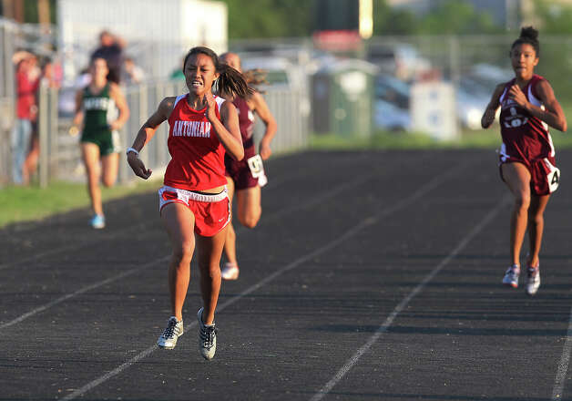 Antonian's Jasmine Acosta pulls away from the pack to take first in the 400-meter dash at the TAPPS 2-5A track meet championships at Antonian High School on Tuesday, April 10, 2012. Photo: Kin Man Hui, San Antonio Express-News / ©2012 San Antonio Express-News