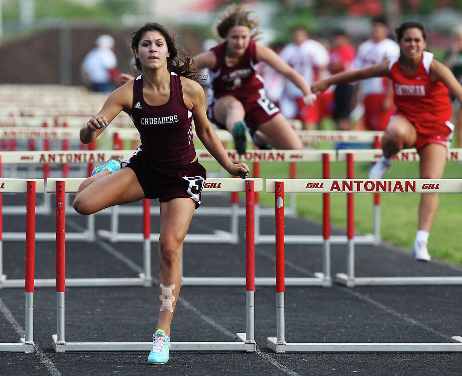 Austin St. Michael's Annie Callegari clears the last hurdle to finish first in the 100-meter hurdles at the TAPPS 2-5A track meet championships at Antonian High School on Tuesday, April 10, 2012. Photo: Kin Man Hui, San Antonio Express-News / ©2012 San Antonio Express-News