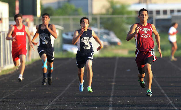 St. Anthony's Francisco Chavez (right) leads the pack to finish first in the 400-meter dash at the TAPPS 2-5A track meet championships at Antonian High School on Tuesday, April 10, 2012. Photo: Kin Man Hui, San Antonio Express-News / ©2012 San Antonio Express-News