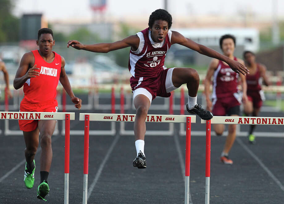 St. Anthony's Charles Hall (center) leaps an obstacle to beat out the rest of the group in the 300-meter hurdles at the TAPPS 2-5A track meet championships at Antonian High School on Tuesday, April 10, 2012. Photo: Kin Man Hui, San Antonio Express-News / ©2012 San Antonio Express-News