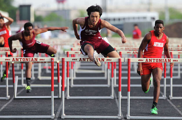 St. Anthony's Hoon Seol (center) clears the last hurdle to take first in the 110-meter hurdles against Antonian's Douglas Bradshaw (right) and Austin St. Michael's Malcolm Postell (left) at the TAPPS 2-5A track meet championships at Antonian High School on Tuesday, April 10, 2012. Photo: Kin Man Hui, San Antonio Express-News / ©2012 San Antonio Express-News
