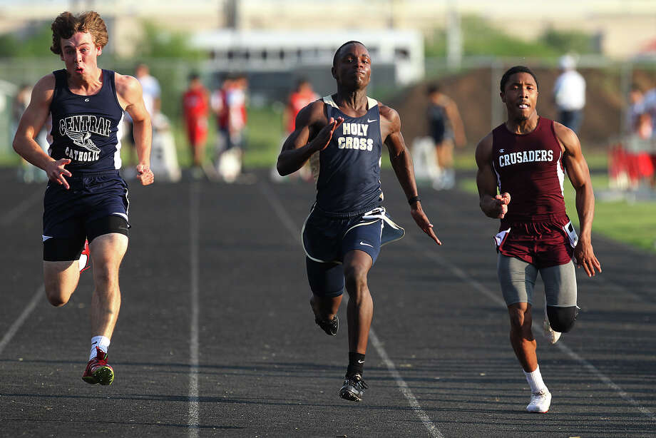 Kendal Williams of Holy Cross (center) outpaces Central Catholic's Walker Sinclair (left) and Austin St. Michael's Quinta Goode to take first in the 100-meter dash at the TAPPS 2-5A track meet championships at Antonian High School on Tuesday, April 10, 2012. Photo: Kin Man Hui, San Antonio Express-News / ©2012 San Antonio Express-News