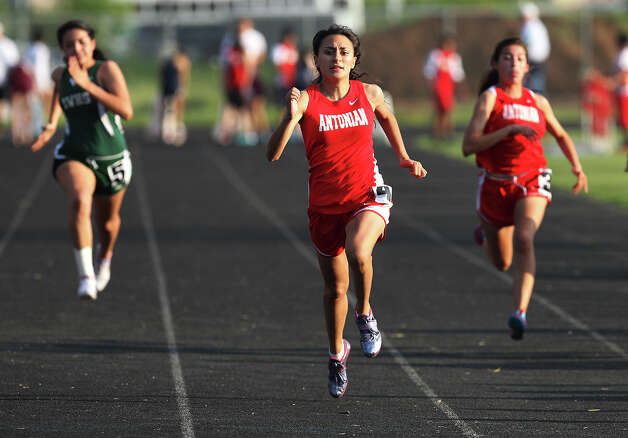 Antonian's Cassandra Santos takes first in the 100-meter dash at the TAPPS 2-5A track meet championships at Antonian High School on Tuesday, April 10, 2012. Photo: Kin Man Hui, San Antonio Express-News / ©2012 San Antonio Express-News