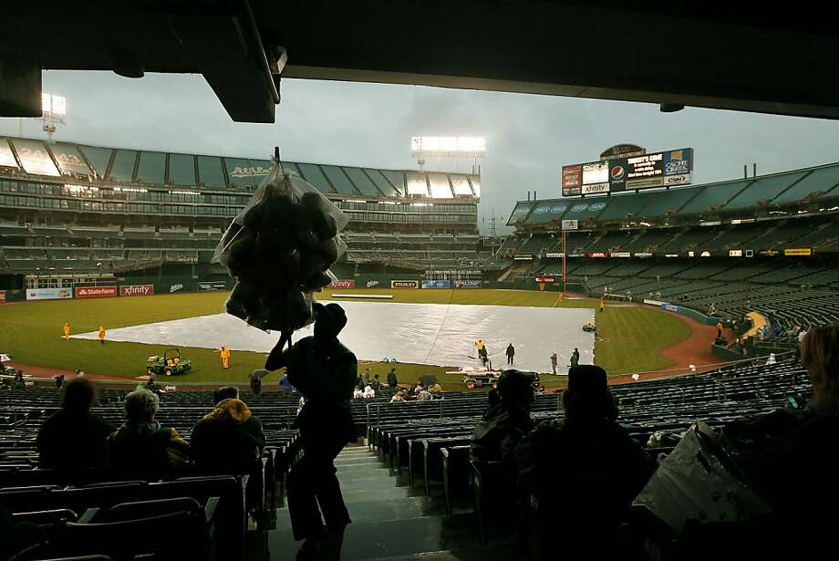 A cotton candy vendor works the stands during a rain delay as the Oakland Athletics prepare to take on the Kansas City Royals in major league baseball action at the O.Co Coliseum on Tuesday April 10, 2012, in Oakland, Ca. Photo: Michael Macor, The Chronicle