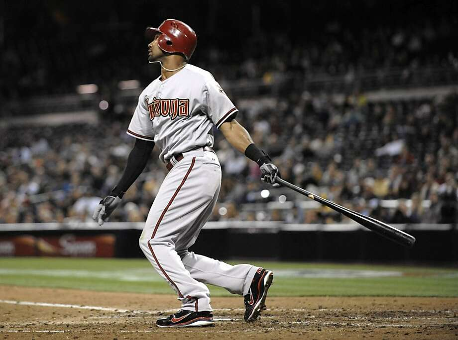 Chris Young of the Arizona Diamondbacks hits a two-run home run during the 10th inning against the San Diego Padres. Photo: Denis Poroy, Getty Images
