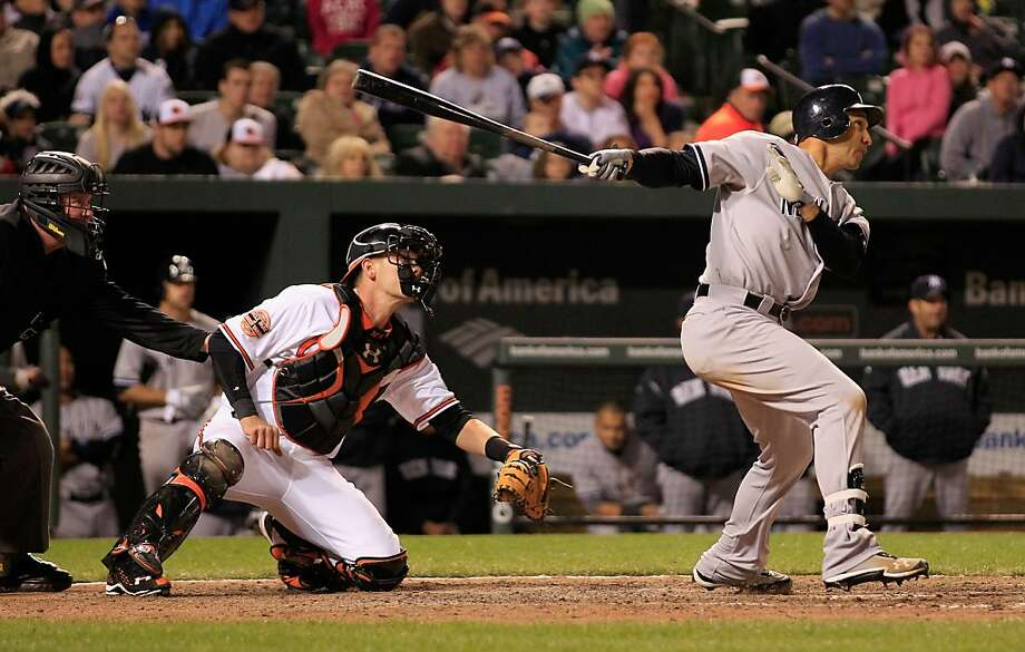 BALTIMORE, MD - APRIL 10: Raul Ibanez #27 of the New York Yankees follows his game winning RBI double as catcher Matt Wieters #32 of the Baltimore Orioles looks on during the 12th inning at Oriole Park at Camden Yards on April 10, 2012 in Baltimore, Maryland. The Yankess won 5-4.  (Photo by Rob Carr/Getty Images) Photo: Rob Carr, Getty Images