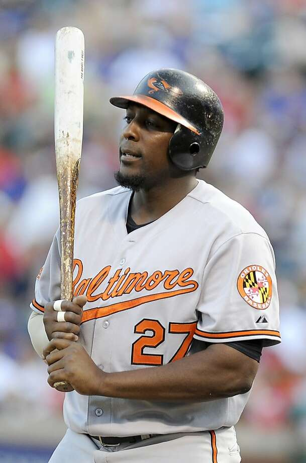 FILE - This July 5, 2011 file photo shows Baltimore Orioles designated hitter Vladimir Guerrero during an at bat in the third inning of a baseball game against the Texas Rangers, in Arlington, Texas. Former major-leaguer Guerrero says he has turned himself over to police in the Dominican Republic after reportedly being involved in a scuffle with a police officer in a disco. (AP Photo/Matt Strasen, File) Photo: Matt Strasen, Associated Press