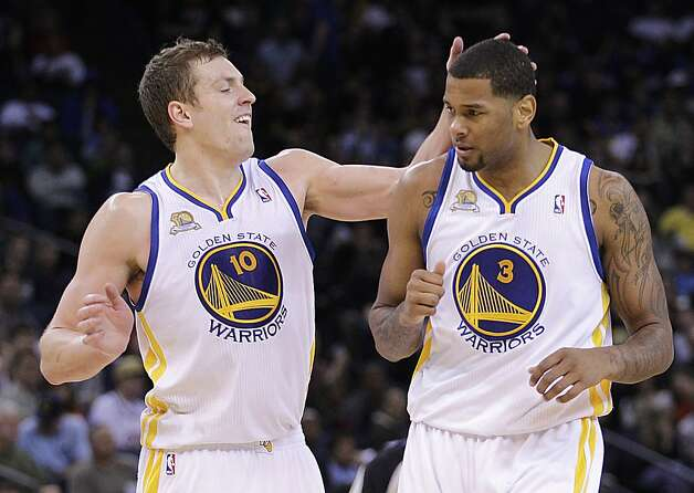 Golden State Warriors' David Lee, left, congratulates teammate Jeremy Tyler after Tyler scored against the Denver Nuggets during the second half of an NBA basketball game Saturday, April 7, 2012, in Oakland, Calif. Photo: Ben Margot, Associated Press
