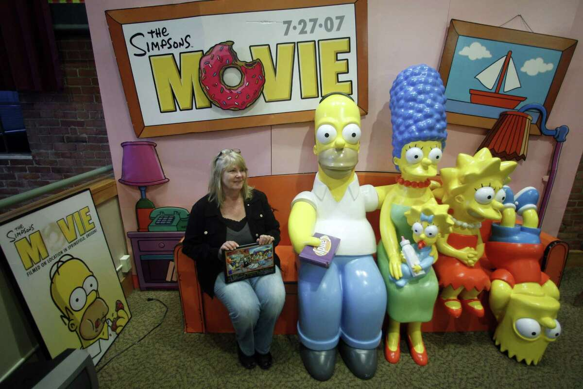 Debra Gruell, Executive Director of the Springfield Museum, sits on the The Simpsons Couch at the museum Tuesday, April 10, 2012, in Springfield, Ore. One of the best-kept secrets in television history has been revealed, with