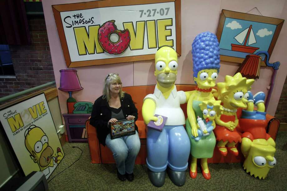 "Debra Gruell, Executive Director of the Springfield Museum, sits on the The Simpsons Couch at the museum Tuesday, April 10, 2012, in Springfield, Ore. One of the best-kept secrets in television history has been revealed, with ""The Simpsons"" creator Matt Groening pointing to Springfield, Ore., as the inspiration for the animated hometown of Homer and his dysfunctional family. Groening told Smithsonian magazine, published online Tuesday, that he was inspired by the television show ""Father Knows Best,"" which took place in a place called Springfield. Springfield, Ore., is 100 miles south of Groening's hometown of Portland. Photo: Rick Bowmer, AP / AP"