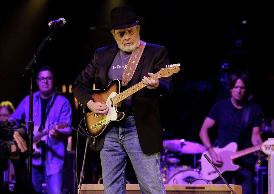Merle Haggard, center, performs with Vince Gill, left, and Keith Urban, right, during the All for the Hall concert on Tuesday, April 10, 2012, in Nashville, Tenn. The concert is a benefit for the Country Music Hall of Fame and Museum. (AP Photo/Mark Humphrey) Photo: Mark Humphrey, Associated Press / AP