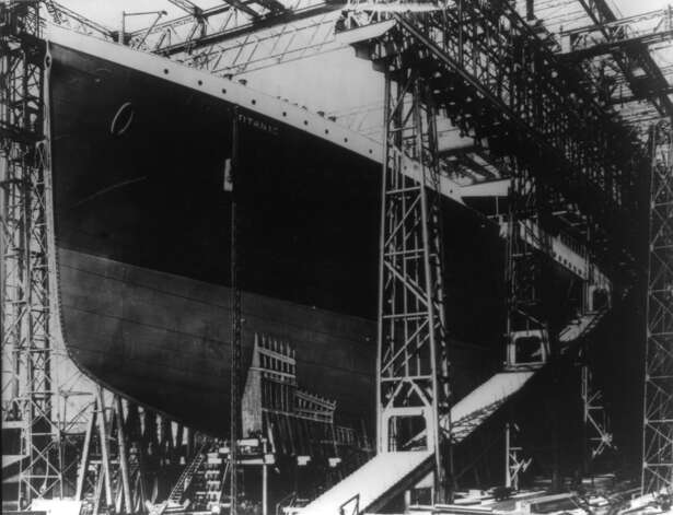 The hull of the RMS Titanic is surrounded by construction scaffolding at a shipyard in Belfast, Northern Ireland. (The New York Times)