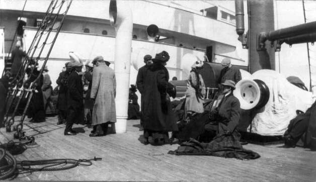 FILE -- Survivors of the sinking of the RMS Titanic rest on the deck of the RMS Carpathia on April 15, 1912.  The largest ship afloat at the time, the Titanic sank in the north Atlantic Ocean on April 15, 1912, after colliding with an iceberg during her maiden voyage from Southampton to New York City.  (The New York Times)