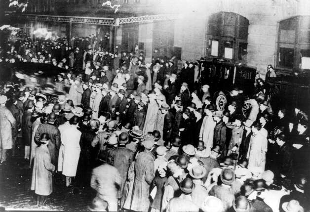 FILE -- People gather in New York to await the arrival of survivors of the sinking of the RMS Titanic aboard the RMS Carpathia on April 18, 1912. The largest ship afloat at the time, the Titanic sank in the north Atlantic Ocean on April 15, 1912, after colliding with an iceberg during her maiden voyage from Southampton to New York City.  (The New York Times)  Photo: THE NEW YORK TIMES, NYT / NYTNS