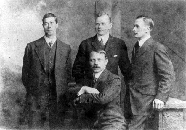 FILE -- Officers who survived the sinking of the RMS Titanic are pictured in an undated photo. From left: Fifth Officer Harold G. Lowe, Second Officer Charles H. Lightoller, Third Officer Herbert J. Pitman (seated) and Fourth Officer Joseph G. Boxhall. The largest ship afloat at the time, the Titanic sank in the north Atlantic Ocean on April 15, 1912, after colliding with an iceberg during her maiden voyage from Southampton to New York City.  (The New York Times)