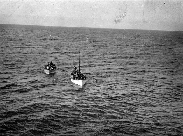 FILE -- Survivors of the sinking of the RMS Titanic approach the RMS Carpathia in this April 15, 1912 photo. The largest ship afloat at the time, the Titanic sank in the north Atlantic Ocean on April 15, 1912, after colliding with an iceberg during her maiden voyage from Southampton to New York City.  (The New York Times)