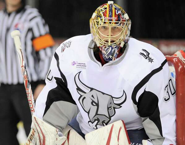 San Antonio Rampage goaltender Jacob Markstrom watches play during the third period of an AHL hockey game against the Milwaukee Admirals, Tuesday, April 10, 2012, in San Antonio. San Antonio won 4-1. Photo: Darren Abate, Darren Abate/pressphotointl.com / Darren Abate/pressphotointl.com