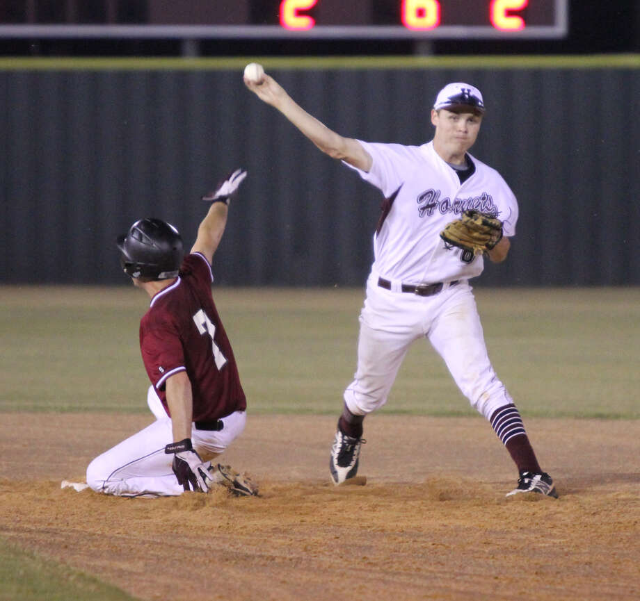 Hudson turns a double play to end Jasper's last threat in the seventh inning. Photo: Jason Dunn