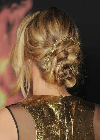 "Actress Jennifer Lawrence, at ""The Hunger Games"" premiere in Los Angeles, wears a mussed yet classy loose braid. Photo: Jason Merritt, Staff / 2012 Getty Images"