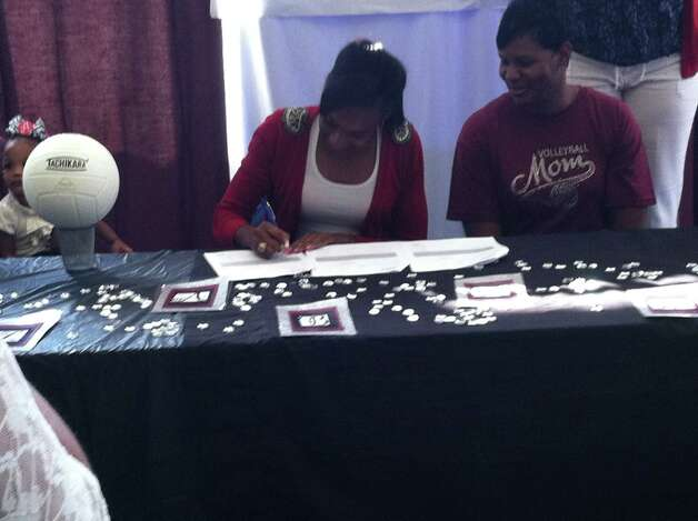 Ozen volleyball player Robyn Hancock signed with Alabama A&M on Wednesday, April 11, 2012. Photo: Jared Ainsworth