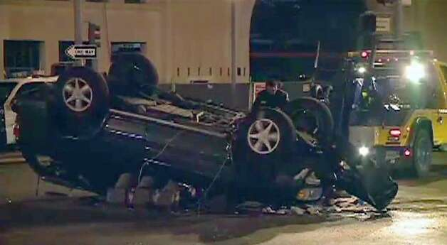 An SUV collided with a number of cars and rolled over on the Embarcadero in San Francisco Wednesday morning, temporarily blocking Muni tracks. Photo: CBS San Francisco