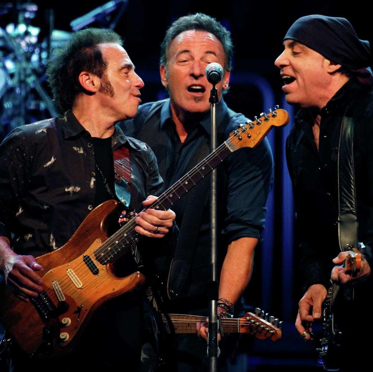 Nils Lofgren, left, Bruce Springsteen, center, and Steven Van Zandt perform with the E Street Band during the Wrecking Ball tour at the Wells Fargo Center Wednesday, March 28, 2012 in Philadelphia. (AP Photo/Alex Brandon)
