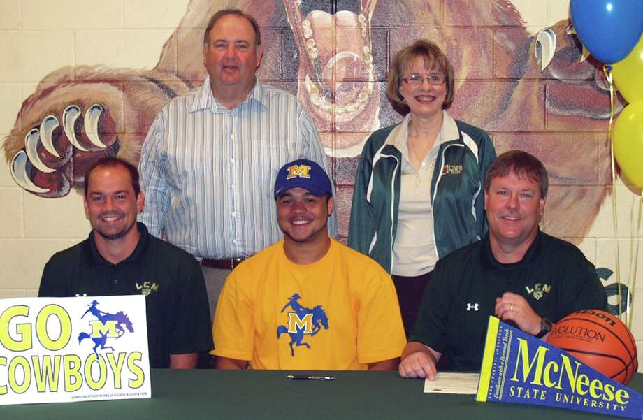 LC-M boys basketball player Jordan Wells signed with McNeese State on Wednesday, April 11, 2012. Photo: Courtesy Of Sherry Combs
