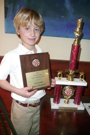 Greenwich resident William Ewald, 7, recently won the first-grade title at the 2012 Connecticut Scholastic State Chess Championship. Photo: Anne W. Semmes