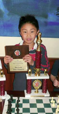 "Greenwich resident Dennis Li recently won the fourth grade championship at the Connecticut Scholastic Chess Championship. Li's win marks the second year in a row he's won the state championship. Last year he took the third grade title. That's a rare event, says his chess coach, Rich Jackson. Li, a student at the International School at Dundee, has taken private lessons from Jackson since the first grade. When asked what he liked about playing chess, Li said, ""I like how you can get a trophy for it and prizes!"". Photo: Anne W. Semmes"