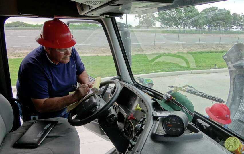 Eugene Martinez inspects a truck during training for drivers at Frac Tech, now called FTS Interna