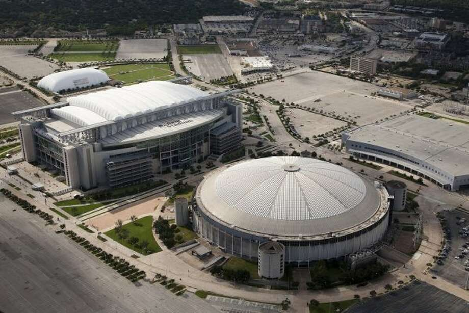 "Houston's Astrodome (right) was once called the ""eighth wonder of the world."""