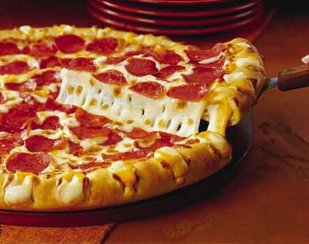 Pizza Hut 3Cheese Stuffed Crust PizzaTotal calories: 350 (per slice of pepperoni pie). Fat grams: 13. Sodium: 920 mg. Carbs: 28 g. Dietary fiber: 1 g. Protein: 15 g. Manufacturer's suggested retail price: $12.What Hoffman says:Pizza Hut says it created the 3 Cheese Stuffed Crust Pizza to appeal to adults who weren't satisfied with a crust oozing merely mozzarella. Apparently, mozzarella is greasy kid's stuff. The addition of white Cheddar and provolone does give the stuffed crust a slightly deeper, more robust flavor. It's something different, and that's really Pizza Hut's game. Photo: Pizza Hut Inc.