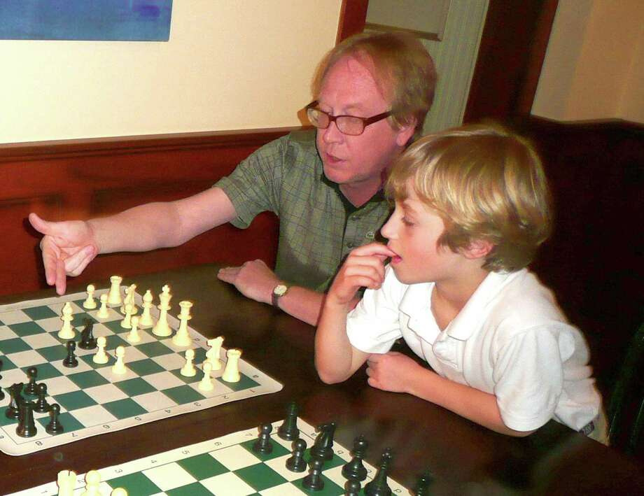 Chess teacher Rich Jackson coached three Greenwich students to state titles this year at the Connecticut State Scholastic Championships - kindergartener Thomas Ewald, first-grader William Ewald and fourth-grader Dennis Li. Photo: Anne W. Semmes