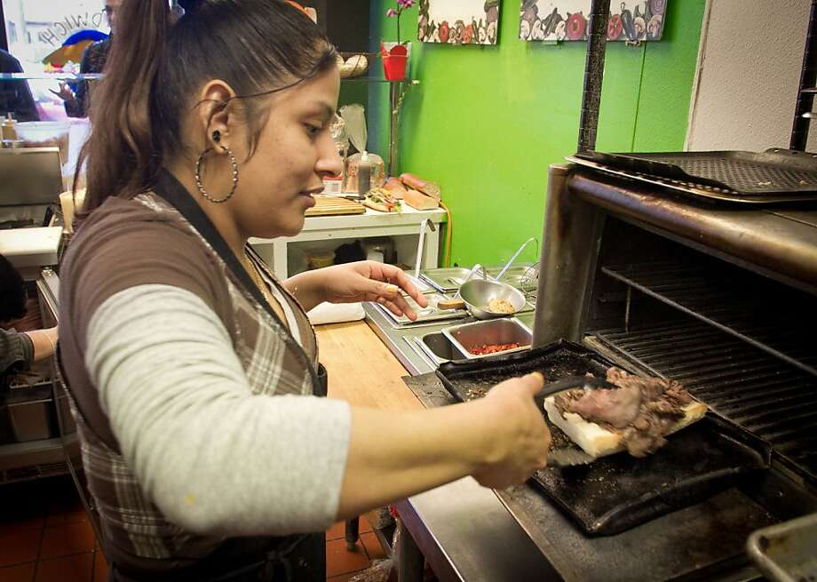 "Patricia Lopez makes ""Al Pacino"" sandwich at the Sandwich Place in San Francisco, Calif. on April 5th, 2012. Photo: John Storey, Special To The Chronicle"