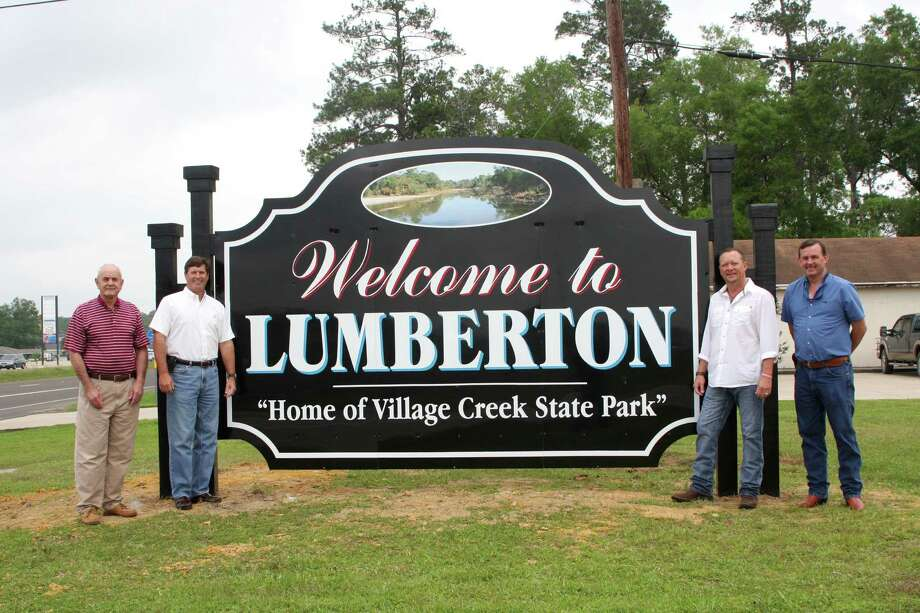 New signs installed on Hwys. 69 and 96 will welcome visitors and residents to Lumberton as they drive into the city. Pictured; from left, Mayor Don Surratt, Entergy Public Relations Mic Cowart, Lumberton Chamber President Andy Kelley, and Lumberton IDC President Rickey Simmons. Photo: David Lisenby, HCN_Signs