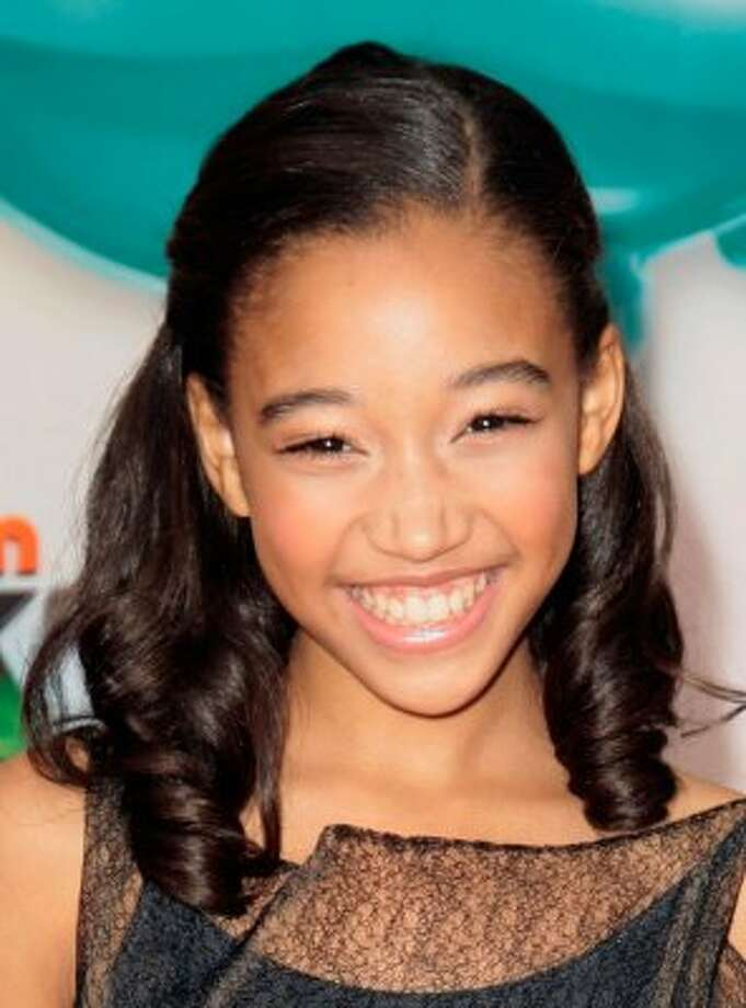"Rue is the hottest new baby name this year.  Amandla Stenberg is the actress who portrays that character in the movie ""Hunger Games.""(Jason Redmond / Associated Press)"