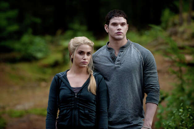 "The ""Twilight"" books inspired interest in the names Bella, Edward and Jacob, but oddly enough Emmett, played by Kellan Lutz on the right, is the most popular name this year. The girl-versions, Emma and Emily, are also popular.  Photo: Kimberley French, Summit Entertainment / handout"