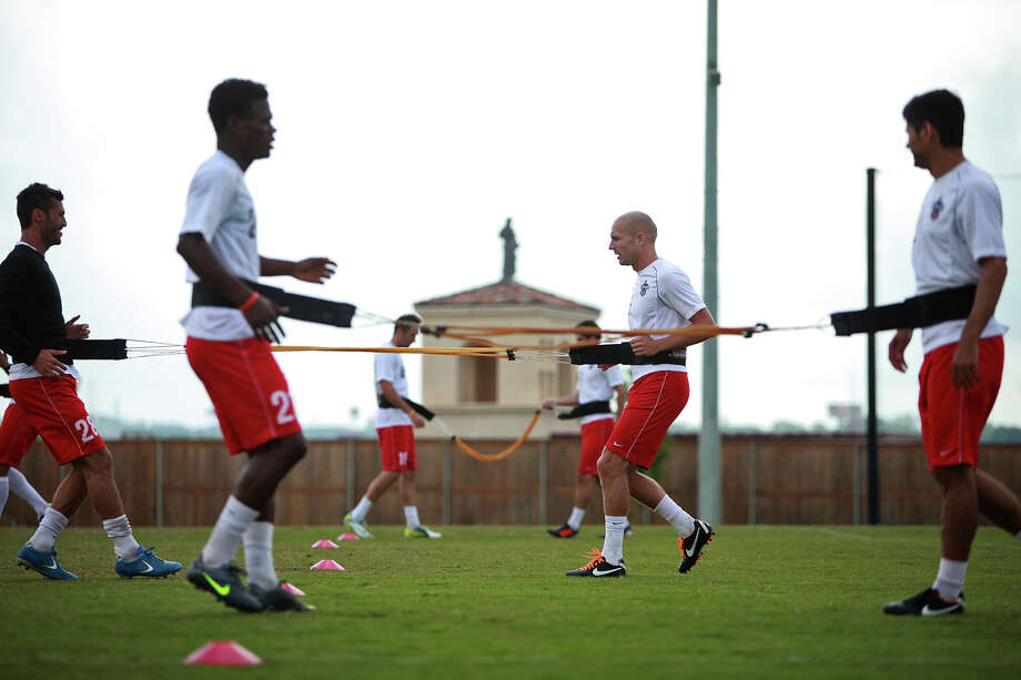 San Antonio Scorpions players go through drills as they practice at the STAR Soccer Complex on Wednesday, April 11, 2012. Lisa Krantz/San Antonio Express-News Photo: Lisa Krantz, Express-News / SAN ANTONIO EXPRESS-NEWS