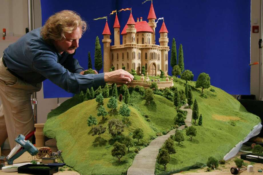 "A photograph of children's author-artist Walter Wick and his castle model, from ""Can You See What I See? Once Upon a Time,"" 2006, is featured in a Walter Wick exhibition, now on view at the Bruce Museum, in Greenwich. Photo: Contributed Photo"