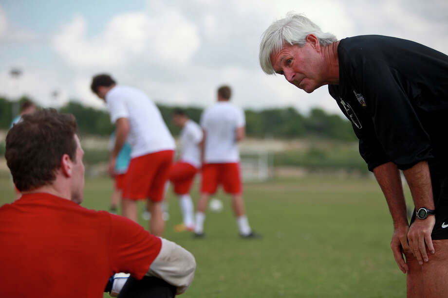 sports - Head Coach Tim Hankinson talks with goalkeeper Pat Hannigan, left, after practice with the San Antonio Scorpions at the STAR Soccer Complex on Wednesday, April 11, 2012. Lisa Krantz/San Antonio Express-News Photo: Lisa Krantz, SAN ANTONIO EXPRESS-NEWS / SAN ANTONIO EXPRESS-NEWS