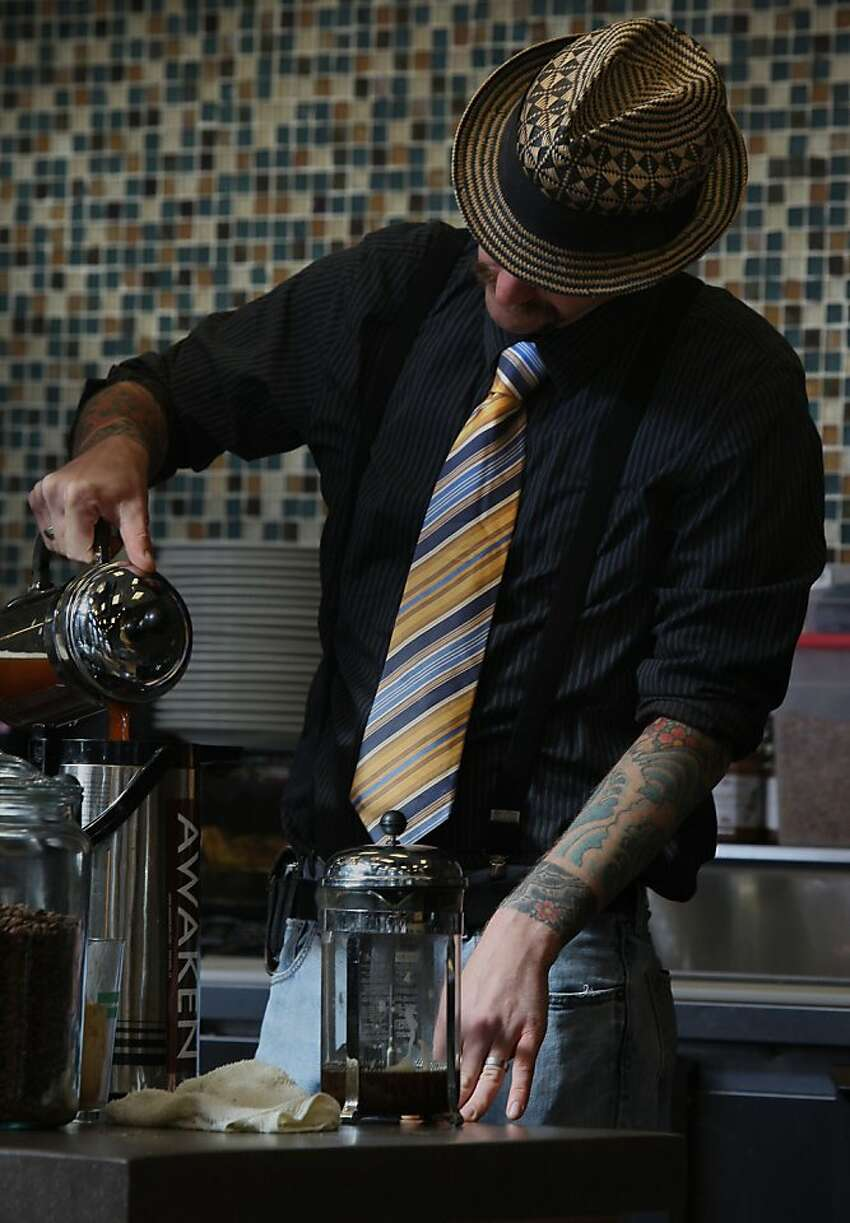 Cortt Dunlap, managing partner of Awaken Cafe, which opened two months ago in Oakland, Calif., making coffee on Tuesday, April 10, 2012.