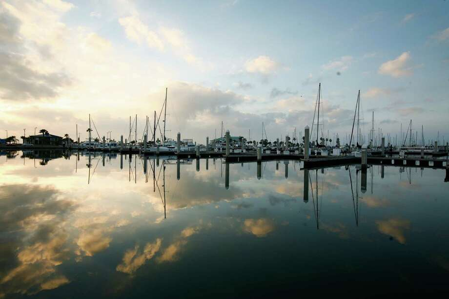 The sun rises behind the Corpus Christi Municipal Marina. Photo: Nick De La Torre / © 2012  Houston Chronicle