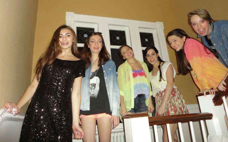 Kelly Gore,left, the Staples High School sophomore who organized the Stride with Pride for Family to Family, leads several of the students downstairs at the Westport Women's Club for the fashion show. To Kelly's left are Meaghan Elliot, Sofia Ribolla, Jamie Yarmoff, Grace McDavid-Seidner, and Sylvie Laxow Photo: Meg Barone / Westport News freelance