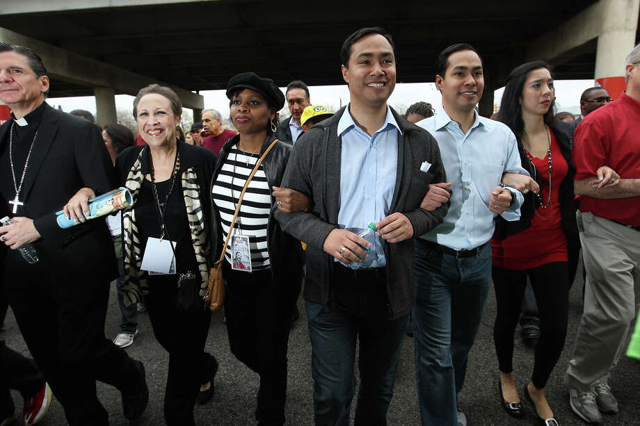 "METRO -- From left, Archbishop Gustavo Garcia-Siller, Aaronetta Hamilton Pierce, District 2 Councilwoman Ivy Taylor, Texas State Rep. Joaquin Castro, Mayor Julian Castro and his wife, Erica, participate in the City of San Antonio Martin Luther King, Jr., 25th anniversary Commemorative March, Monday, Jan. 16, 2012. This year's theme was ""Journey Beyond the March...Live Beyond the Dream"". JERRY LARA/glara@express-news.net Photo: JERRY LARA, San Antonio Express-News / SAN ANTONIO EXPRESS-NEWS"